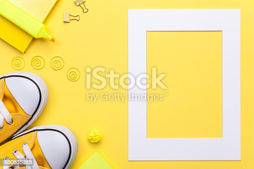 istock School Accessories with White Frame on Yellow Background 680535388