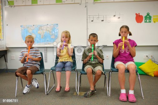 School Age Children Playing Colorful Recorders In ...