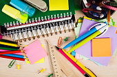 School and office accessories on wooden background