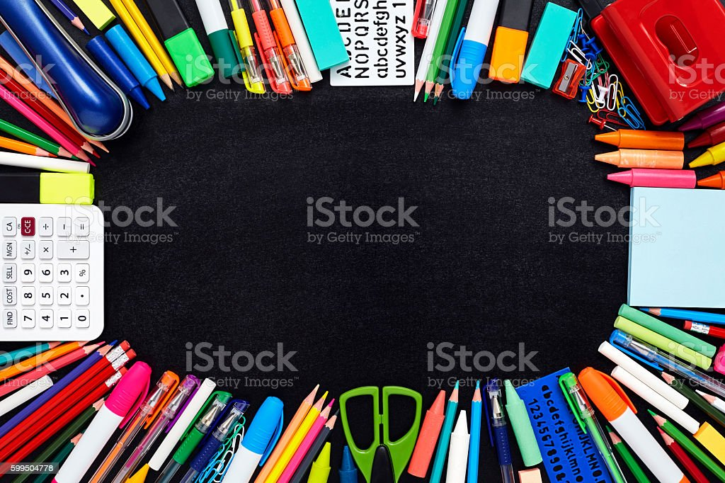 School and office supplies are arranged on chalkboard stock photo