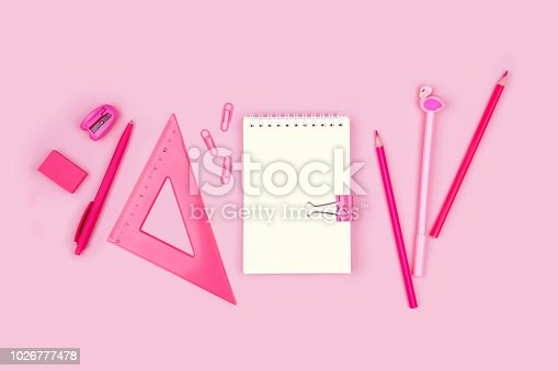istock School and office supplies on pink background. 1026777478