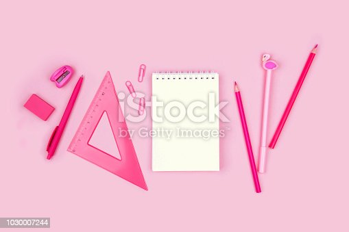 istock School and office supplies on pink background. 1030007244
