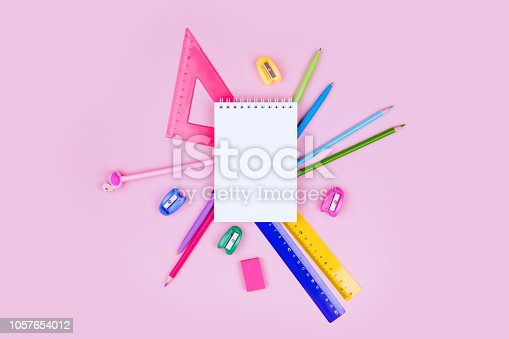 istock School and office supplies on pink background. 1057654012