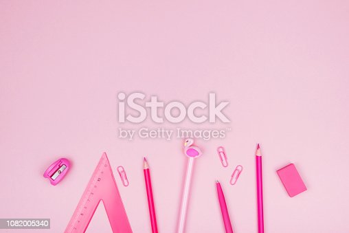istock School and office supplies on pink background. 1082005340