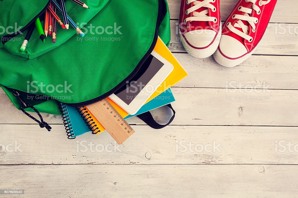 School backpack on wooden background stock photo