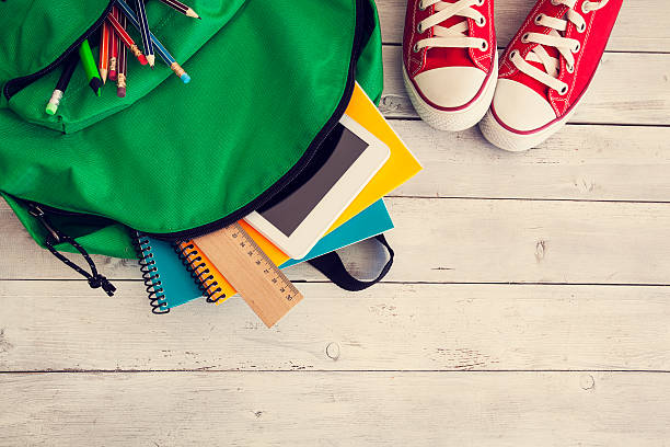 School backpack on wooden background - foto stock