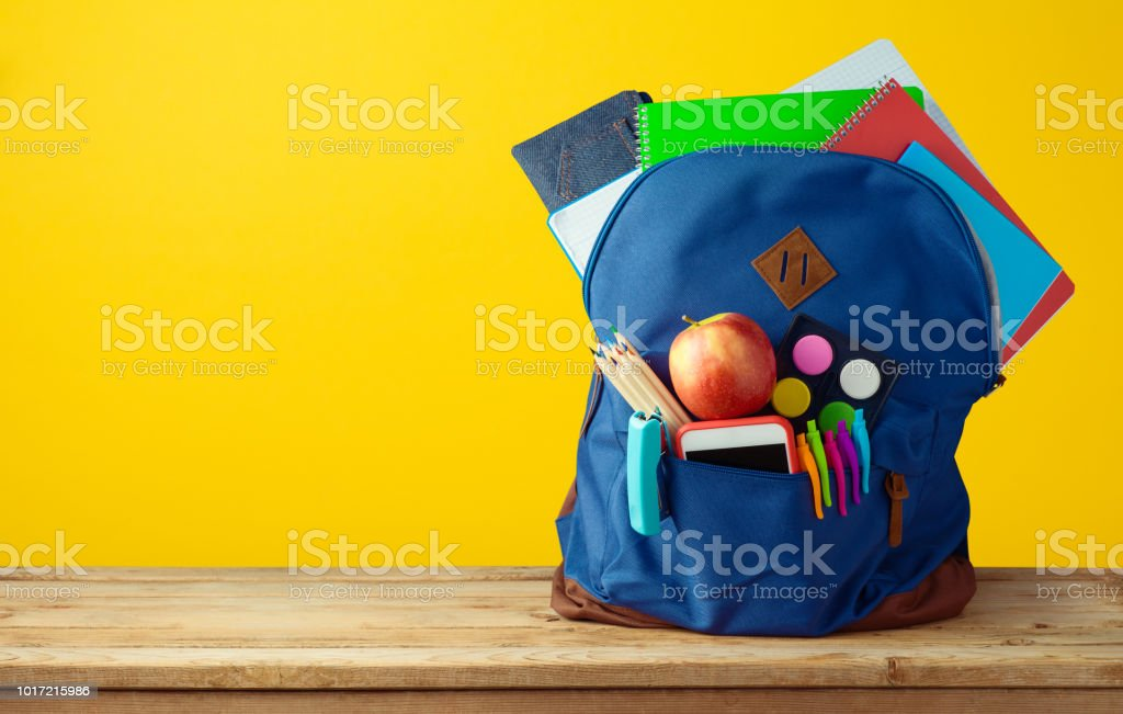 School bag backpack with notebooks stock photo