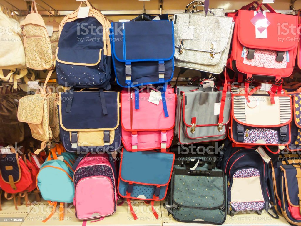 School bags in a supermarket, back to school concept stock photo