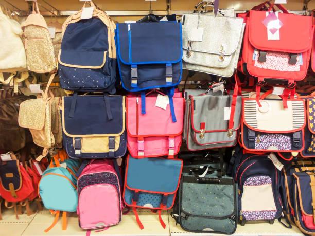 school bags in a supermarket, back to school concept - cartella scolastica foto e immagini stock