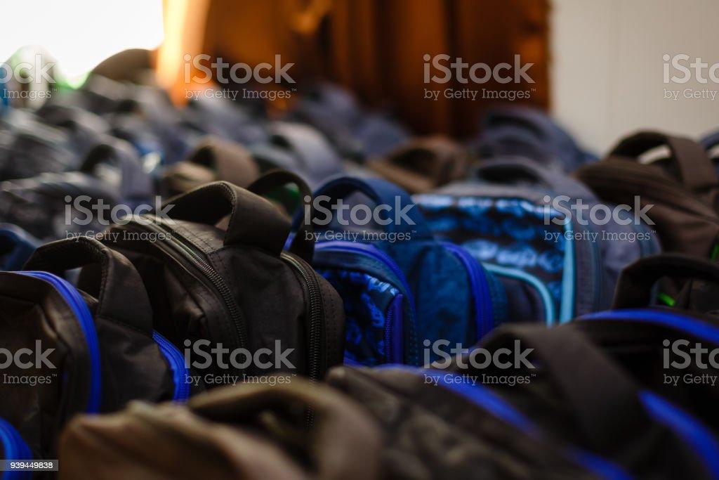 School bags in school concept stock photo