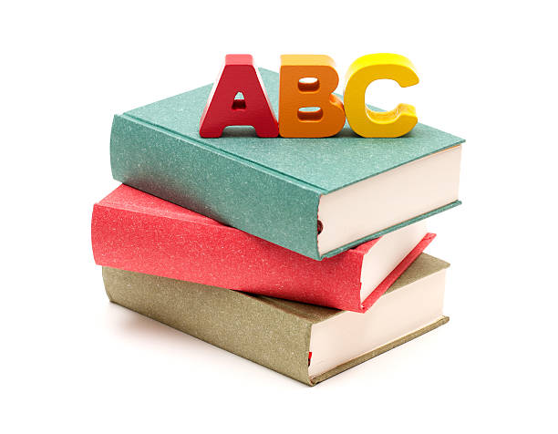 school books and alphabet isolated on white background - alphabetical order stock pictures, royalty-free photos & images