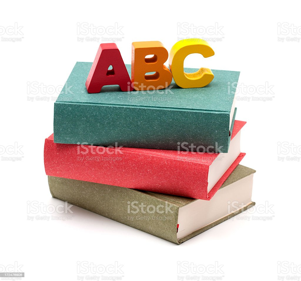 School Books and Alphabet isolated on white background royalty-free stock photo