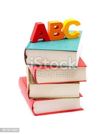 153178960istockphoto School Books and Alphabet isolated on white background 627673352