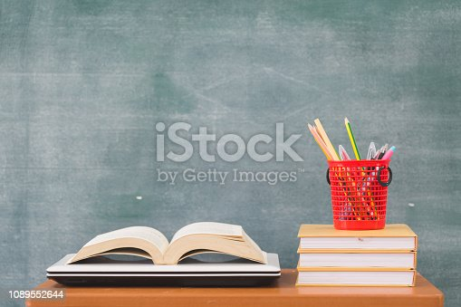 istock School books on desk, Back to school supplies. Books and blackboard on wooden background, education concept 1089552644
