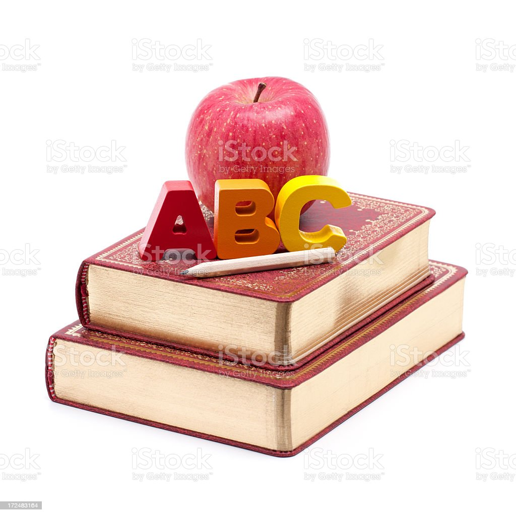 School Books with Apple and Alphabet isolated on white background royalty-free stock photo