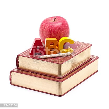 153178960istockphoto School Books with Apple and Alphabet isolated on white background 172483164