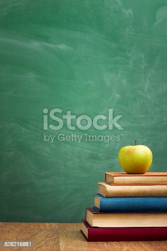 istock School books with apple on desk 526216881