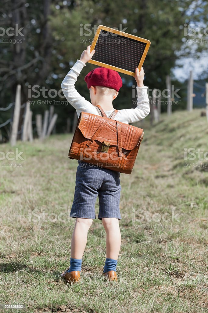 School Boy and his Chalkboard stock photo