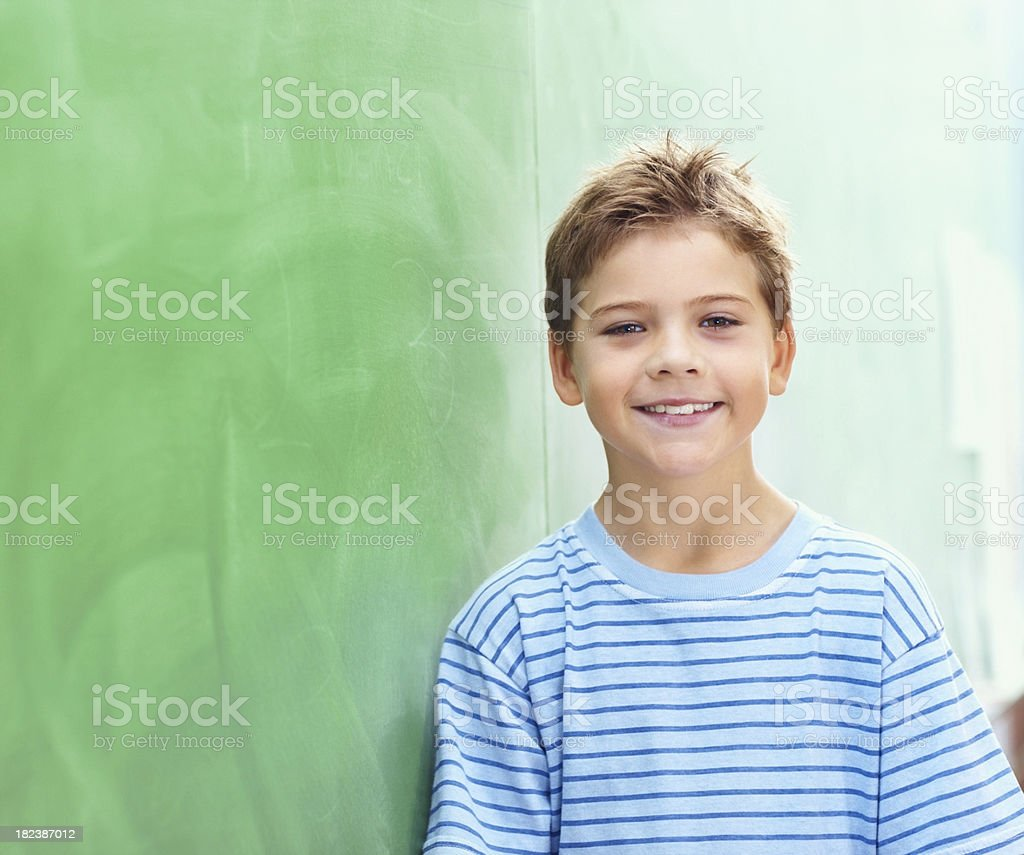 School boy by the board, classroom view royalty-free stock photo