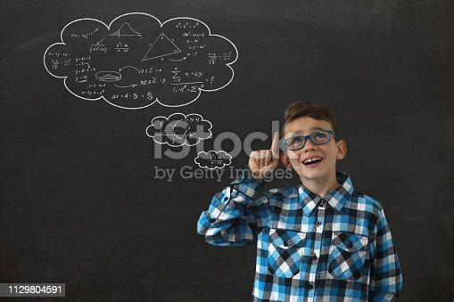 istock School boy child think bright idea education speech bubble blackboard 1129804591