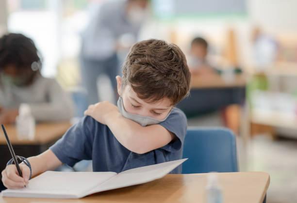 School Boy Coughing Stock Photo stock photo