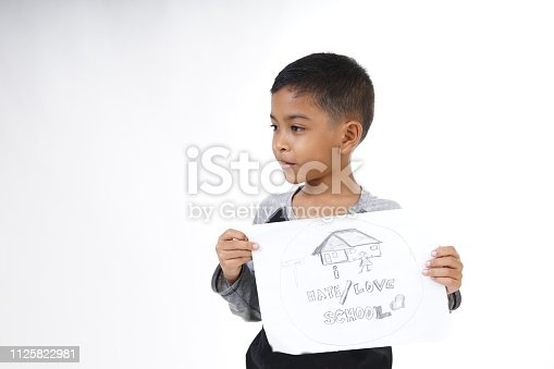 868148002istockphoto School boy Drawing and writing on paper 1125822981