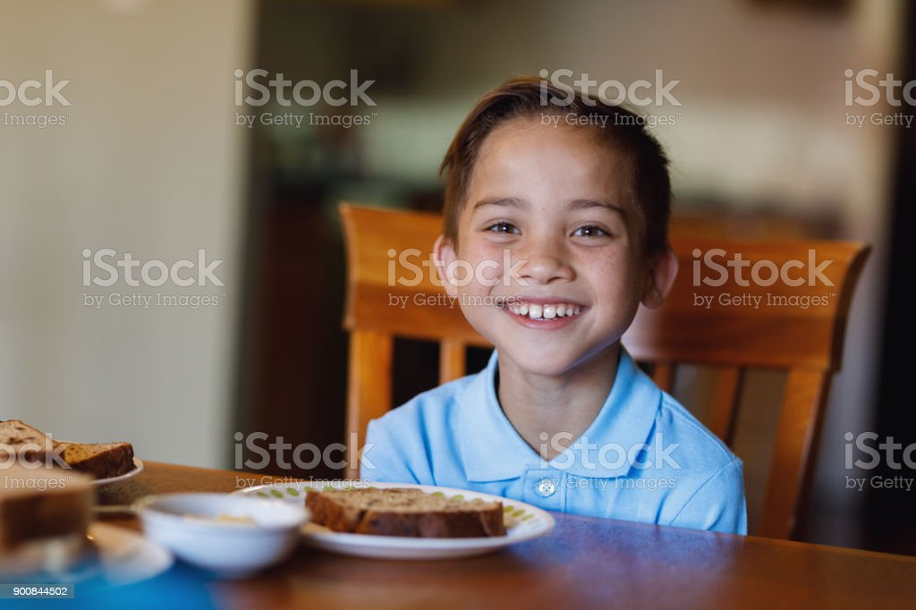 School Boy Having Breakfast stock photo