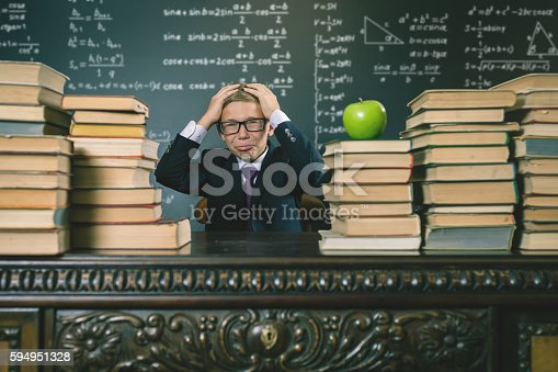 487673332 istock photo School boy in stress or depression at school classroom 594951328