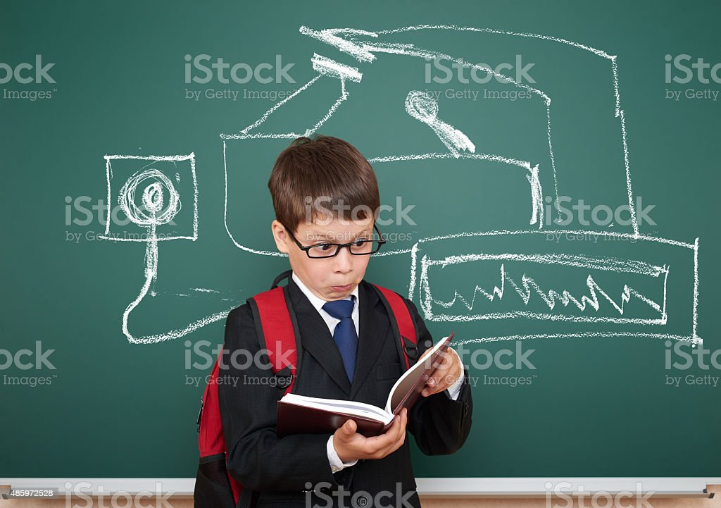 school boy read book about device painted on board stock photo