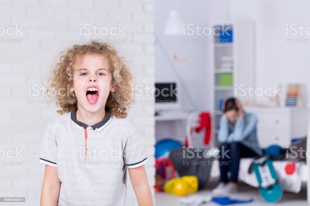 School boy shouting stock photo