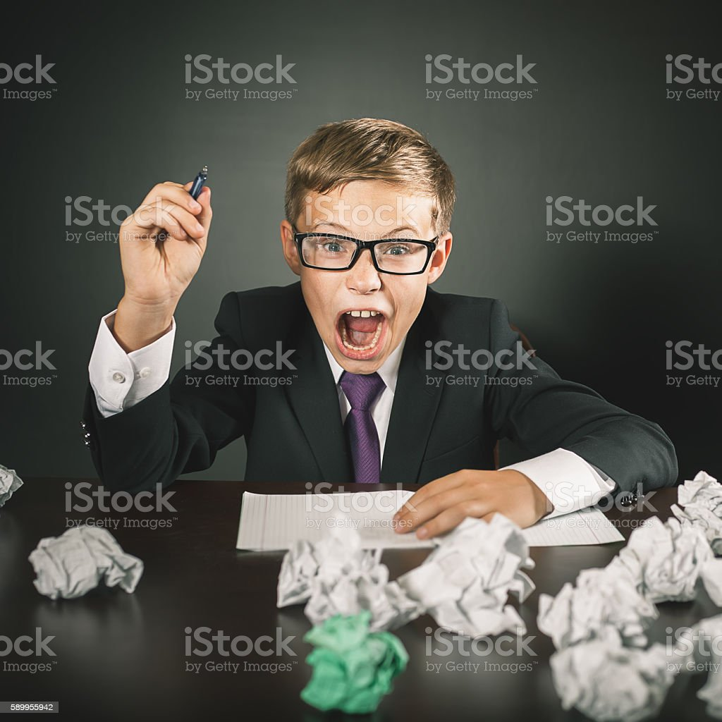 School boy shouts. Stress or depression. stock photo