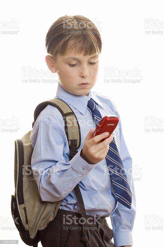 Schule Junge mit Handy Lizenzfreies stock-foto