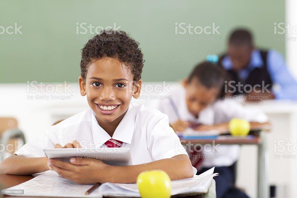 school boy using tablet computer royalty-free stock photo