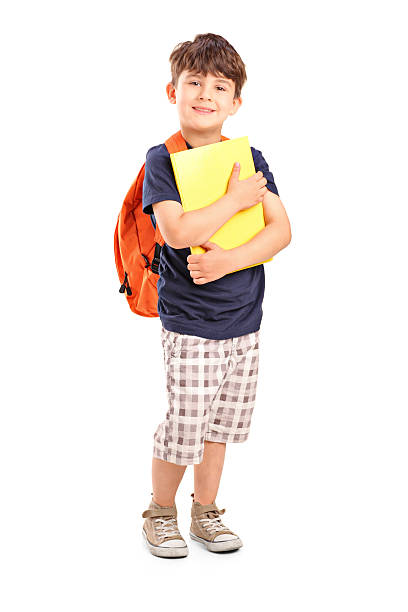 School boy with backpack holding a notebook Full length portrait of a school boy with backpack holding a notebook isolated on white background schoolboy stock pictures, royalty-free photos & images