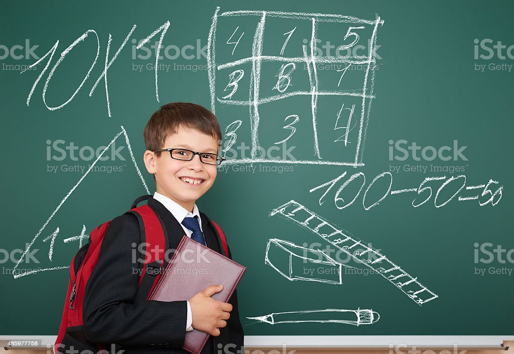 school boy with drawing on board stock photo