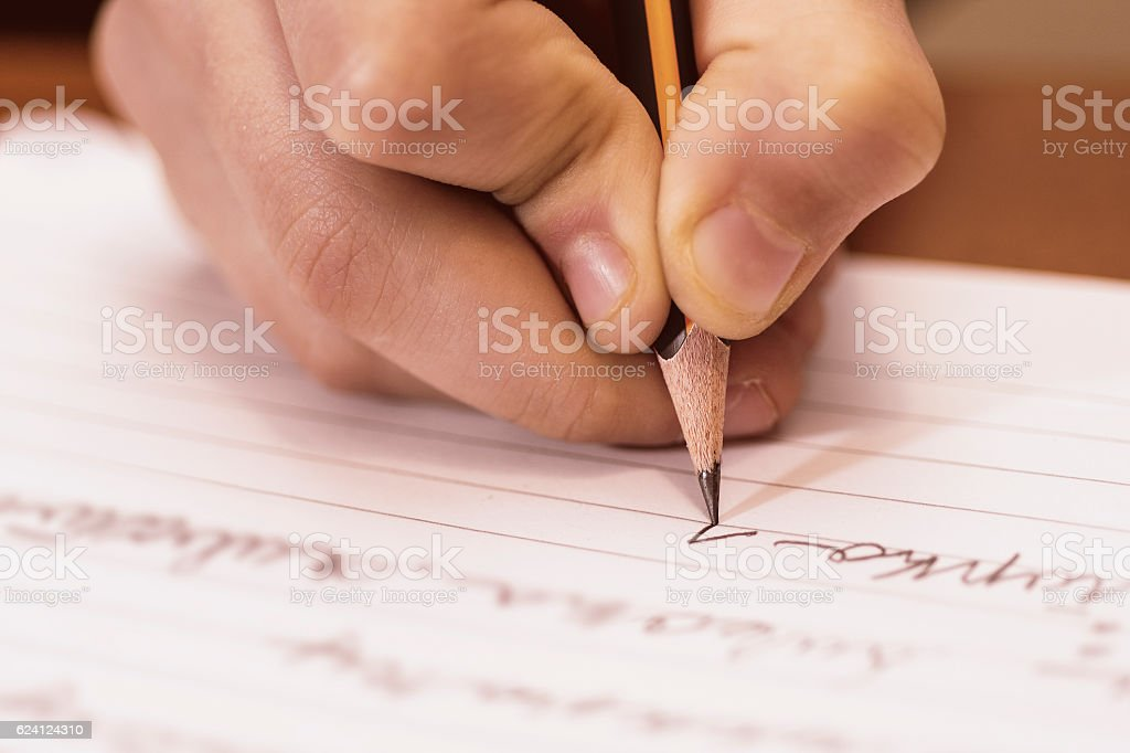 School Boy Writing Close Up. Pencil in Children Hand. - foto de stock