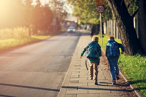 School Boys Running To School Stock Photo - Download Image Now - iStock