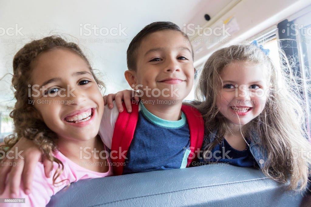 School buddies on the bus stock photo