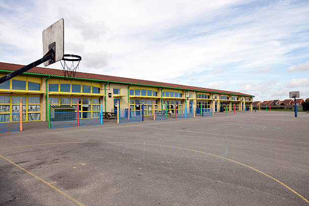 school building and playground - recess stock pictures, royalty-free photos & images