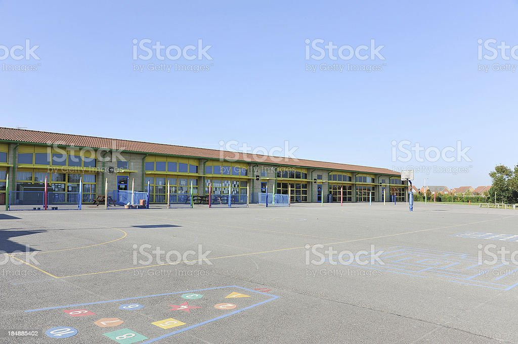 School building and playground royalty-free stock photo