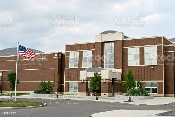 School Building With Flag Stock Photo - Download Image Now