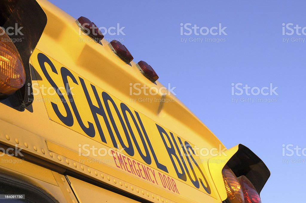 school bus departs royalty-free stock photo