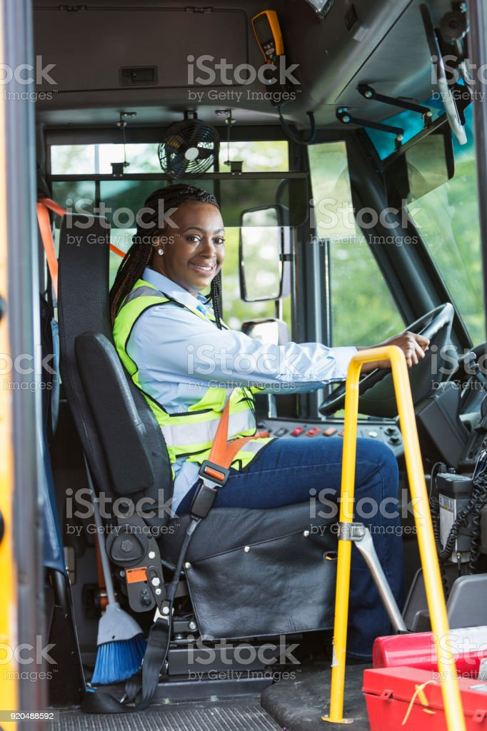 School bus driver looking through doorway stock photo