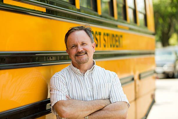 school bus driver - school bus stock photos and pictures