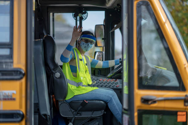 School bus driver wearing protective wear during COVID-19 stock photo