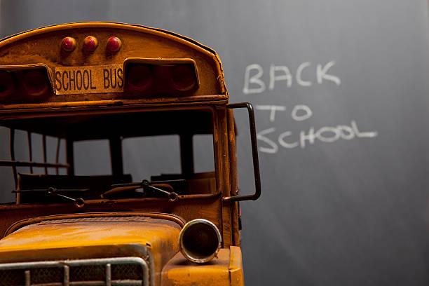 School Bus On Blackboard Background stock photo