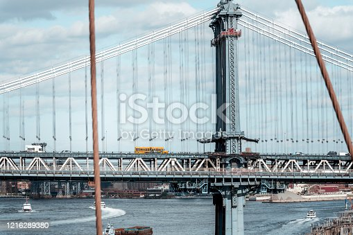 624265498 istock photo School bus on the Manhattan Bridge 1216289380