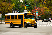 A school bus on the streets of the Bronx, New York city, USA. The Bronx is the northernmost of the five boroughs of New York City, in the U.S. state of New York.