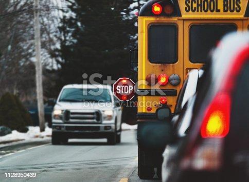 A school bus stops to drop off children.
