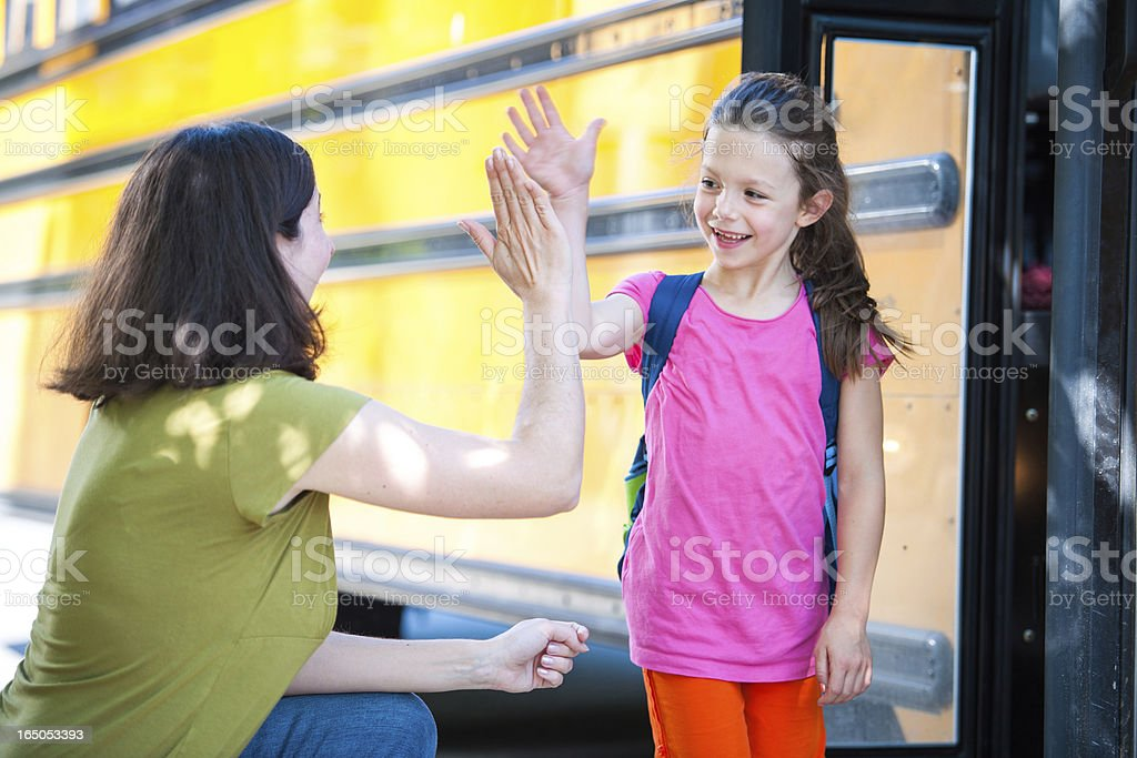 School Bus Series - Giving Mom a High Five stock photo